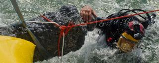 A diver helps raise a cannon from the site of the Queen Anne's Revenge.
