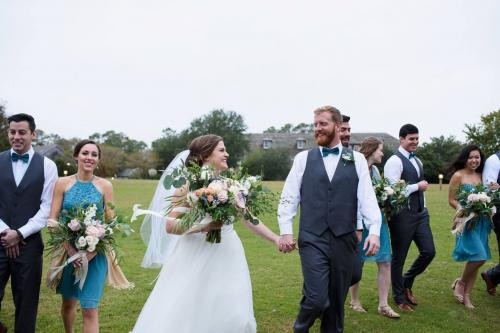 Bride and groom walking with bridal party on the pavilion lawn at Roanoke Island Festival Park