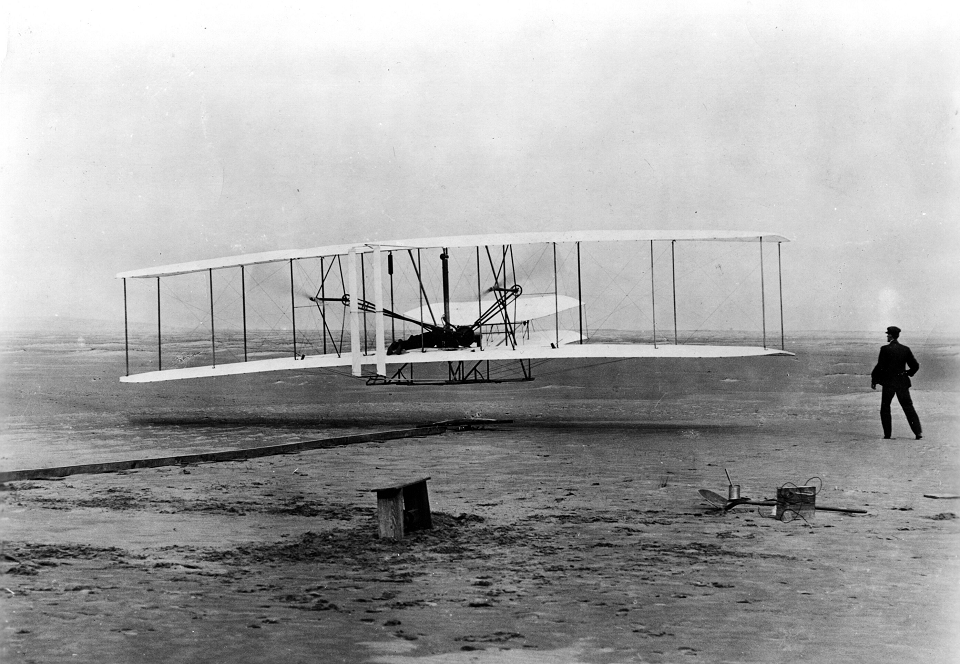 Wright brothers flying their airplane