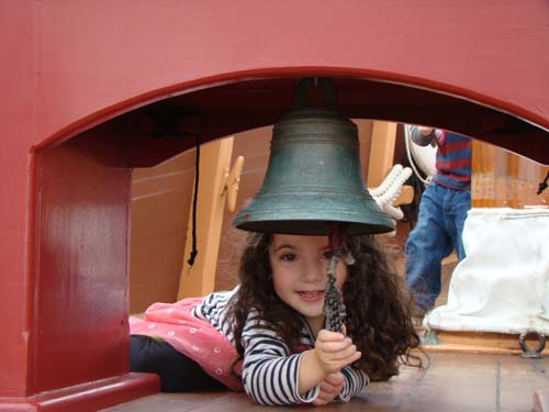 Girl ringing bell on the Elizabeth II ship at Roanoke Island Festival Park