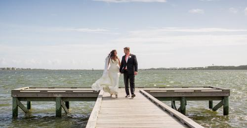 Bride and groom on pier during wedding at Roanoke Island Festival Park