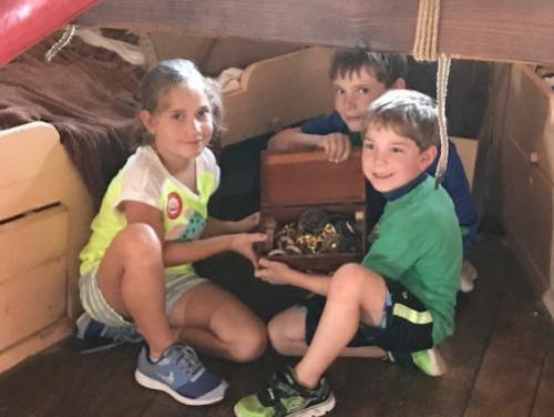 3 kids find treasure below deck on the Elizabeth II at Roanoke Island Festival Park