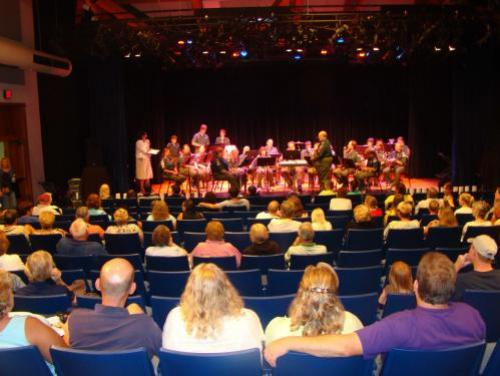 Audience watching performance in the indoor theatre at Roanoke Island Festival Park