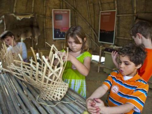 Kids weaving baskets in American Indian Town at Roanoke Island Festival Park