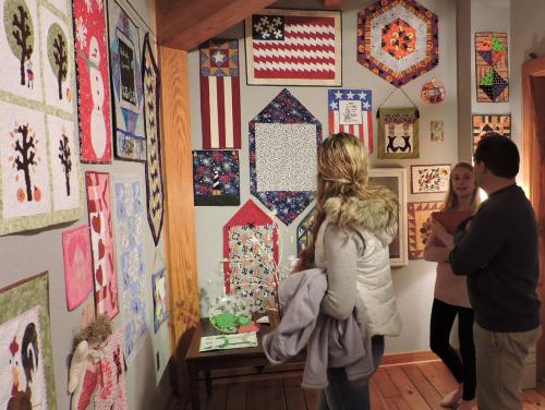 Visitors viewing quilts at the Outer Banks Community Quilt Show