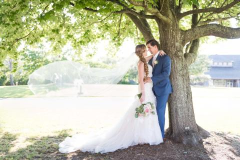 Bride and groom under tree at Roanoke Island Festival Park wedding venue