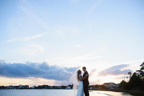 Bride and groom watching the sunset at Roanoke Island Festival Park