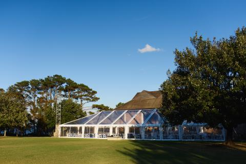 Tent wedding reception on the pavilion lawn at Roanoke Island Festival Park