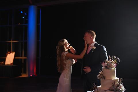 Couple cuts wedding cake at Roanoke Island Festival Park