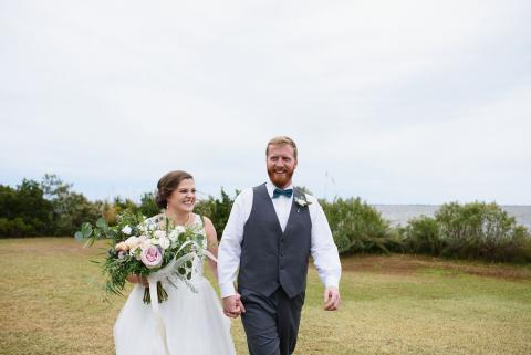 Bride and groom walking the grounds at Roanoke Island Festival Park