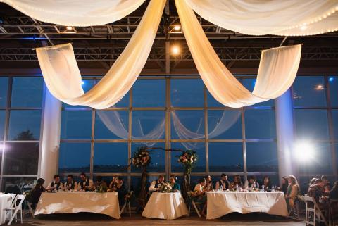 Bridal party setting at the reception on the pavilion stage at Roanoke Island Festival Park