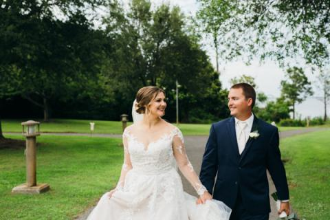 Bride and groom walking the pavilion grounds at Roanoke Island Festival Park
