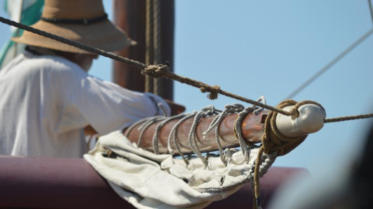 Sailor preparing to raise the sail on the Elizabeth II ship at Roanoke Island Festival Park