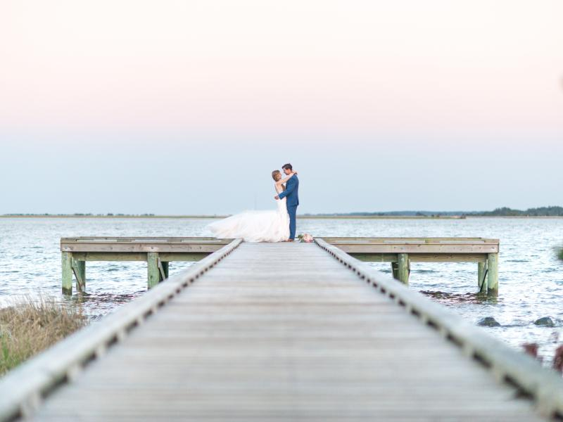 Couple on pier at Roanoke Island Festival Park wedding venue