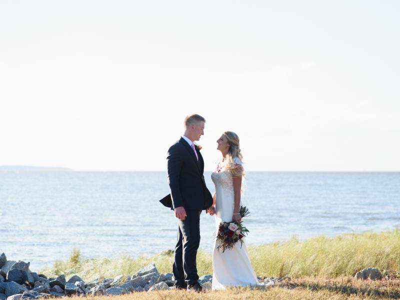 Bride and groom by the waterfront at Roanoke Island Festival Park