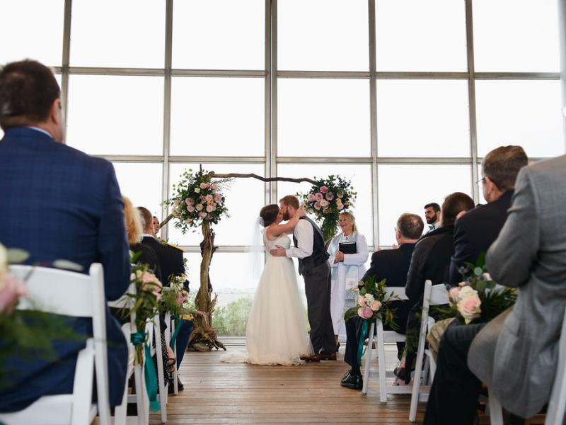 Bride and grooms first kiss as a married couple on the pavilion stage at Roanoke Island Festival Park