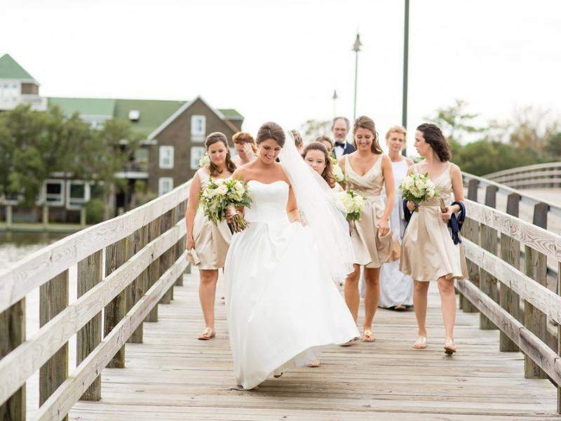 Bridal party walking over the bridge to Festival Park