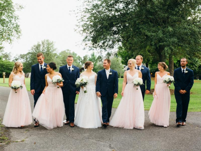 Wedding party walking the pavilion grounds at Roanoke Island Festival Park