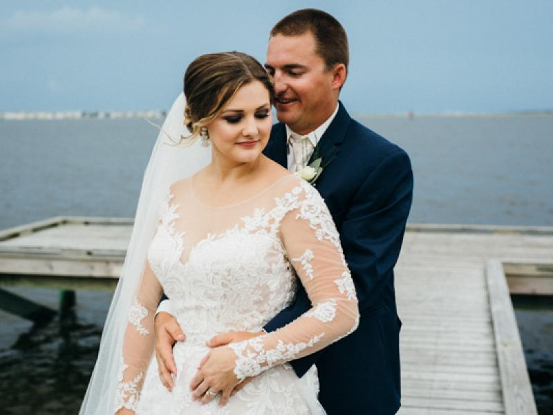 Bride and groom on the t-dock at Roanoke Island Festival Park