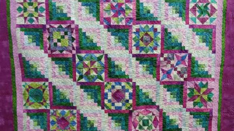Purple raffle quilt featured at the annual Quilt Show at Roanoke Island Festival Park