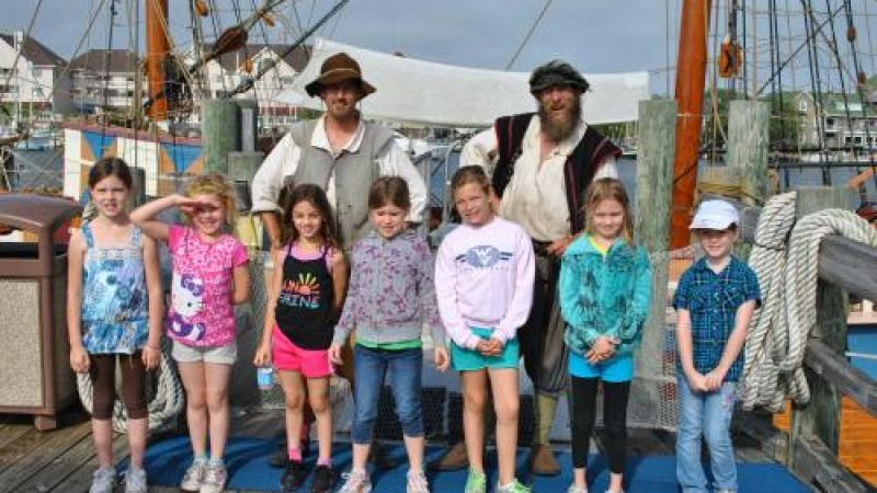 Girl scout group with historic interpreters on the Elizabeth II at Roanoke Island Festival Park