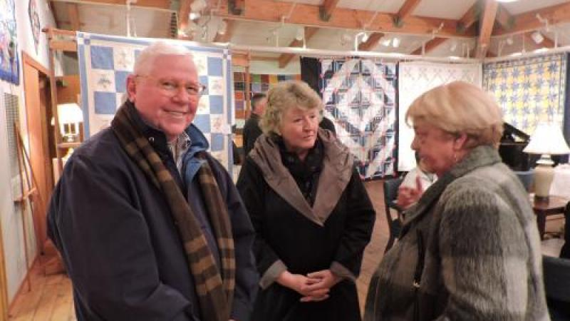 Three seniors talking at the Outer Banks Community Quilt Show Reception