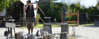 Historic interpreter performs gun drill at Roanoke Island Festival Park