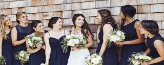 Bride and bridesmaid on the side of the Pavilion Stage at Roanoke Island Festival Park