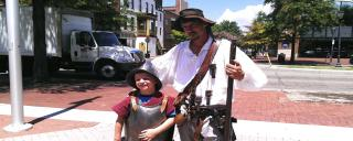Roanoke Island Festival Park historic interpreter with student at an outreach program