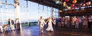 Bride and Groom walking into wedding reception at Roanoke Island Festival Park