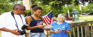 Volunteer greeting guests at Roanoke Island Festival Park