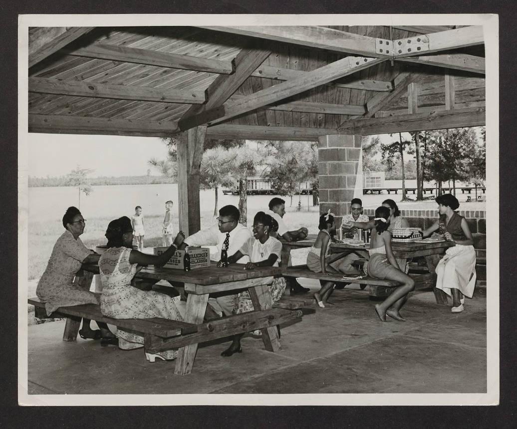 Family picnicking at Jones Lake State Park, circa 1950. North Carolina State Parks Collection.