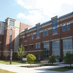 exterior of multi-story red brick building with lots of windows.  William E. Laupus Health Sciences Library on the Health Sciences Campus of East Carolina University.
