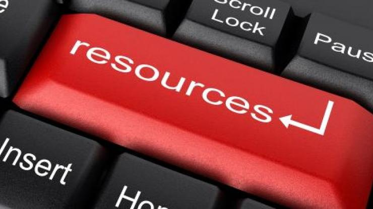 a red key in place of the return key on a keyboard that says resources
