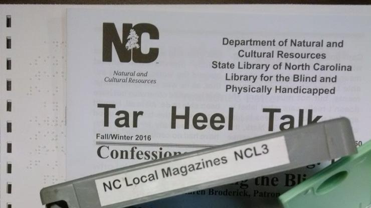 A copy of Tar Heel Talk in braille, talking book and large print lays on table