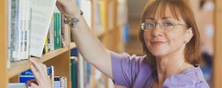 Librarian in front of books