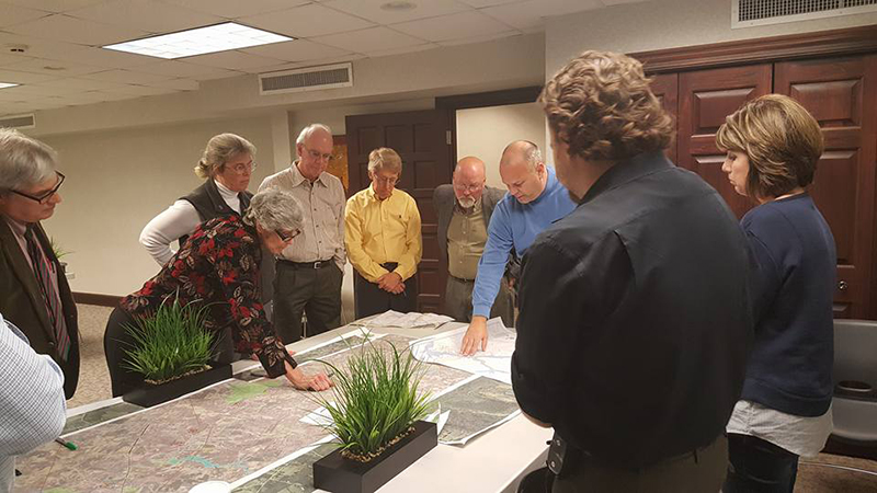 Members of the North Carolina Trails program and Trails Committee work on trail plans.