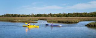 Kayakers explore the paddling trail at Hammocks Beach State Park.