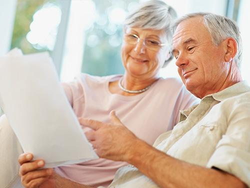 Senior couple looking at documents