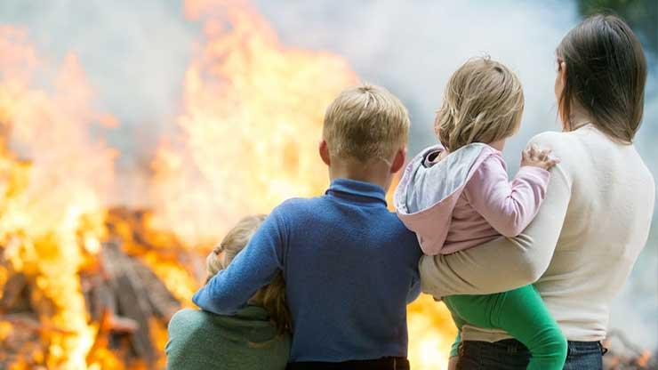 Family watching home burn