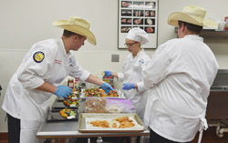 Student Culinary team competes in cooking contest.