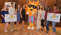 Students help promote summer meals programs with Ray.