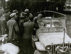 Survivors around a jeep