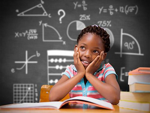 Girl in front of chalkboard with geometry equations.