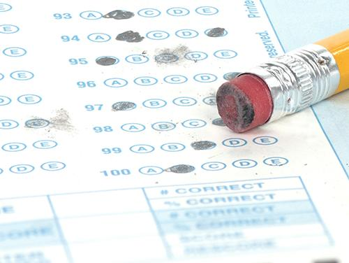 Image of a scantron test and a pencil eraser.