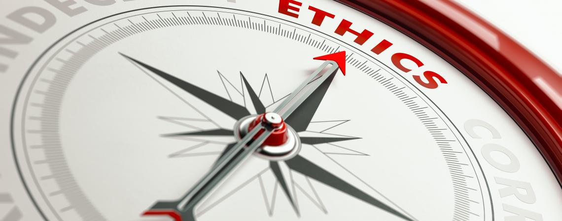 Red compass to word Ethics