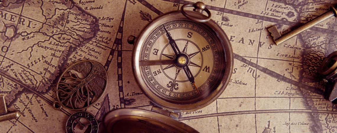 Old style compass on the map