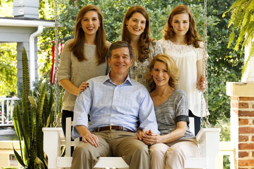 Governor Roy Cooper, First Lady Kristin Cooper and their 3 daughters on the porch