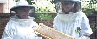 First Lady Kristin Cooper with beekeeper at the Governor's Mansion