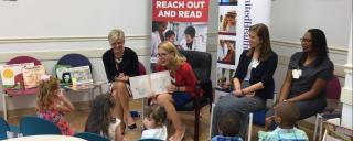 First Lady Kristin Cooper reads to young children